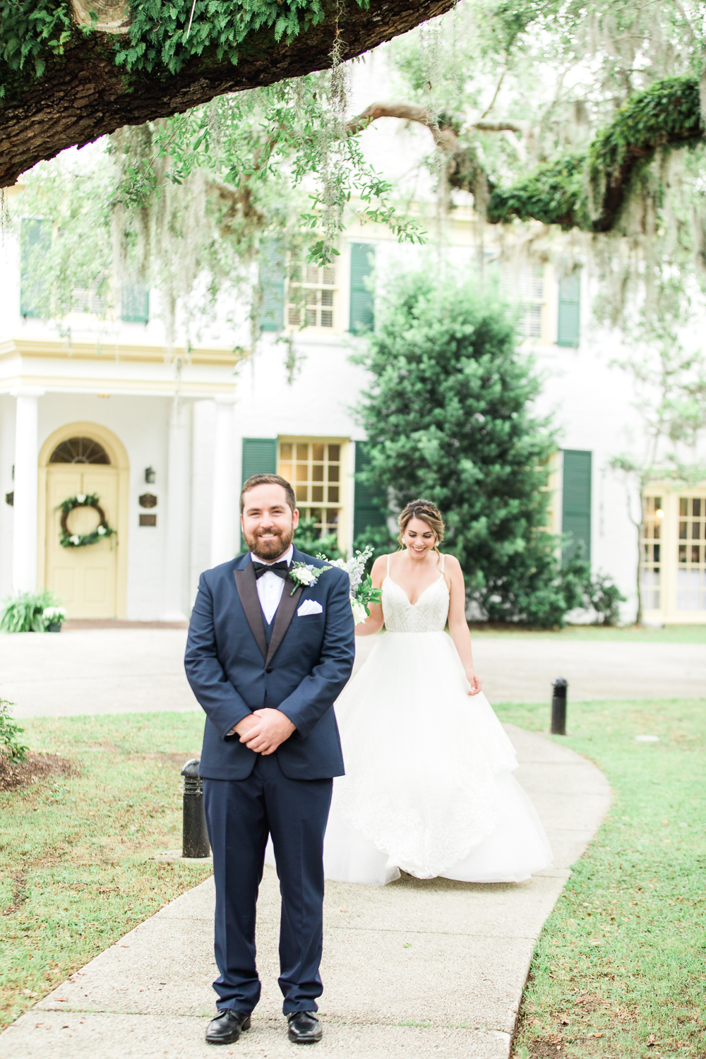 bride and groom first look in the ribault club wedding