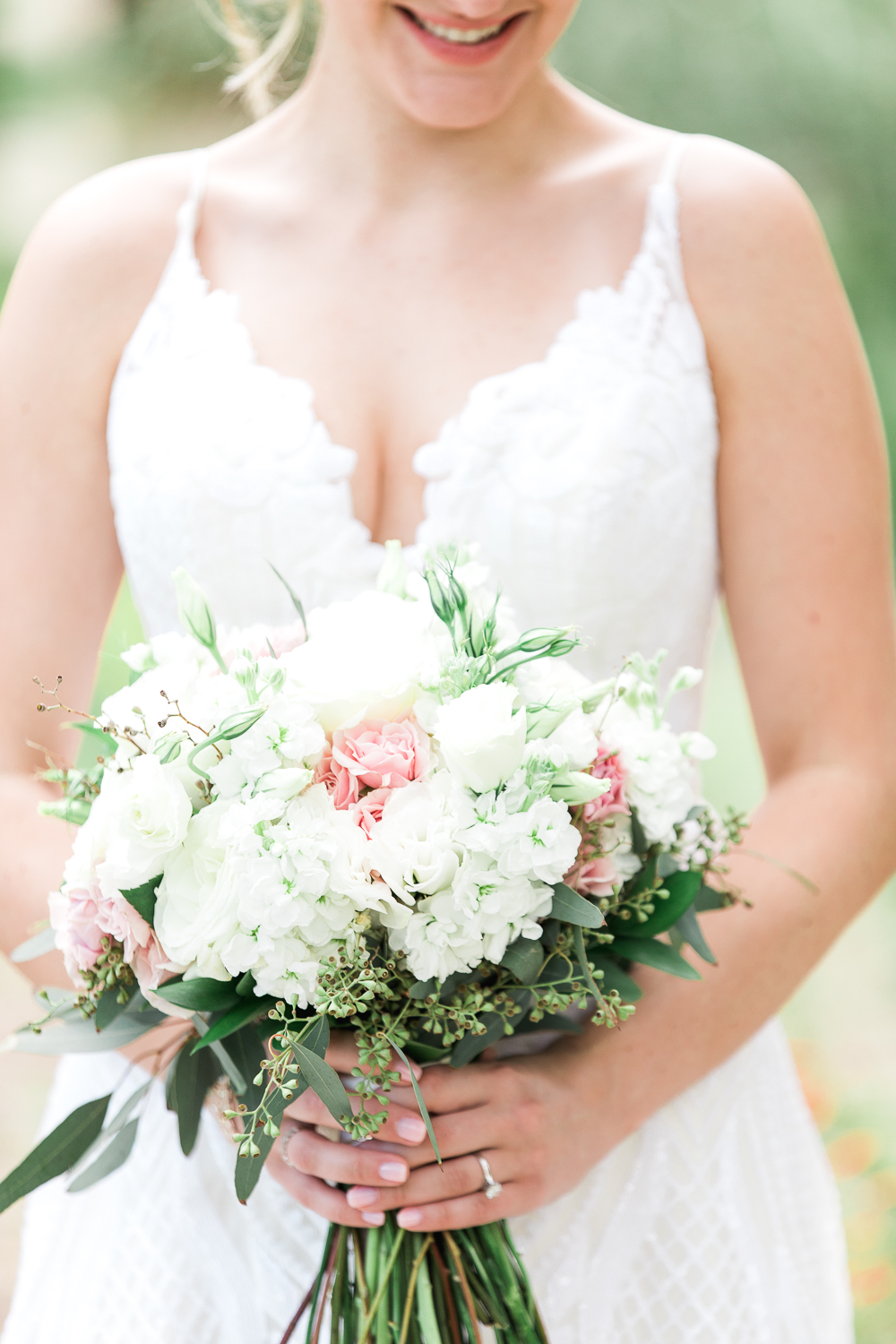 Bride in her Delta by Hayley Paige dress and flowers by Fantasy in Flowers