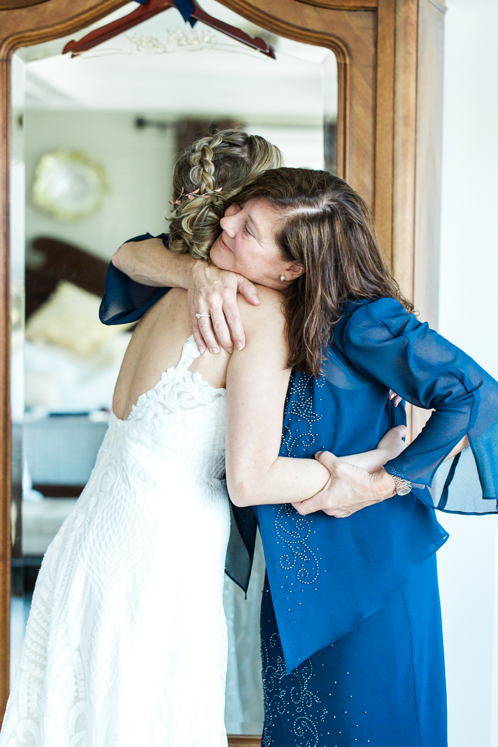 Bride hugging her mom