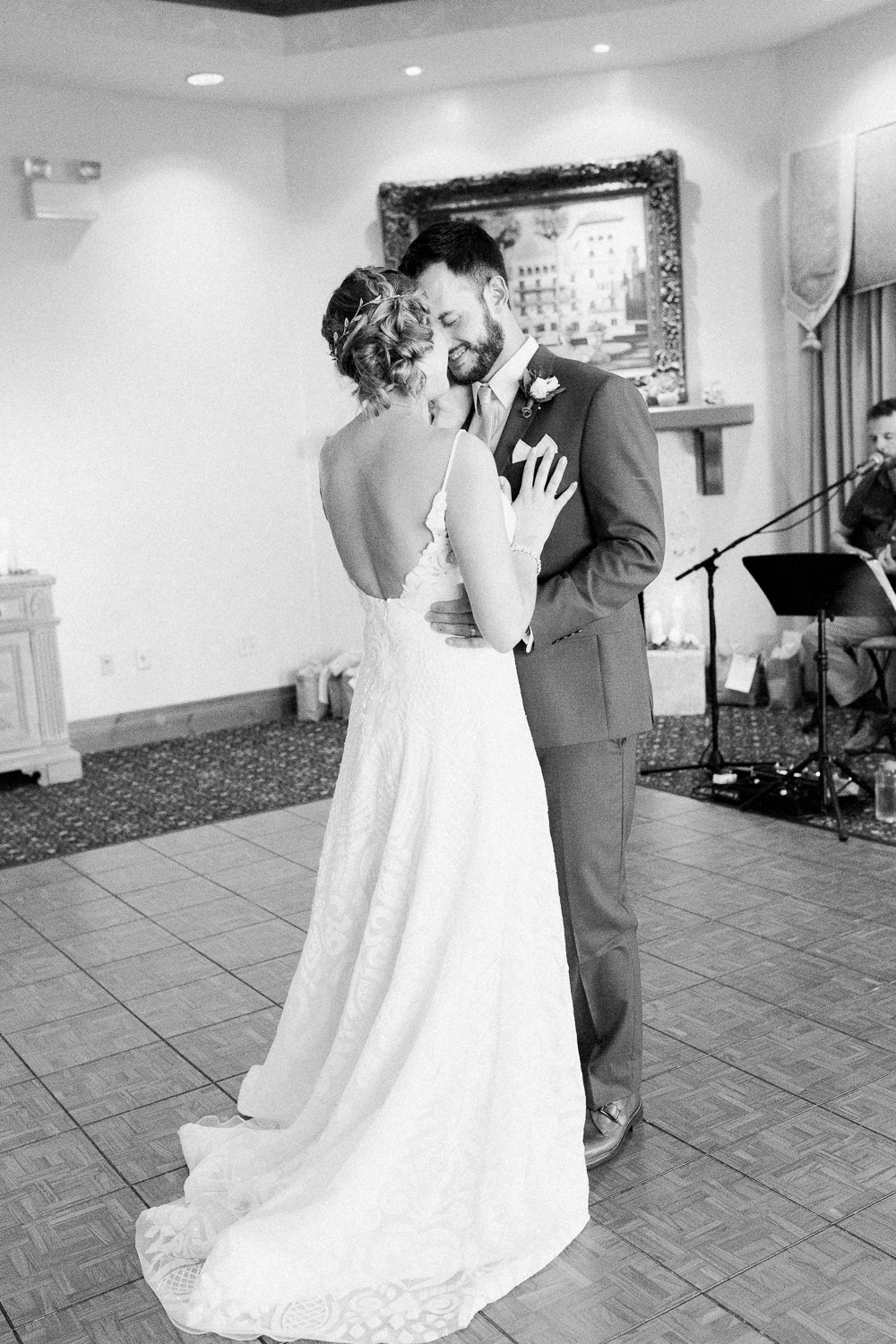 B&W image of bride and groom's first dance in Serenata Beach Club wedding