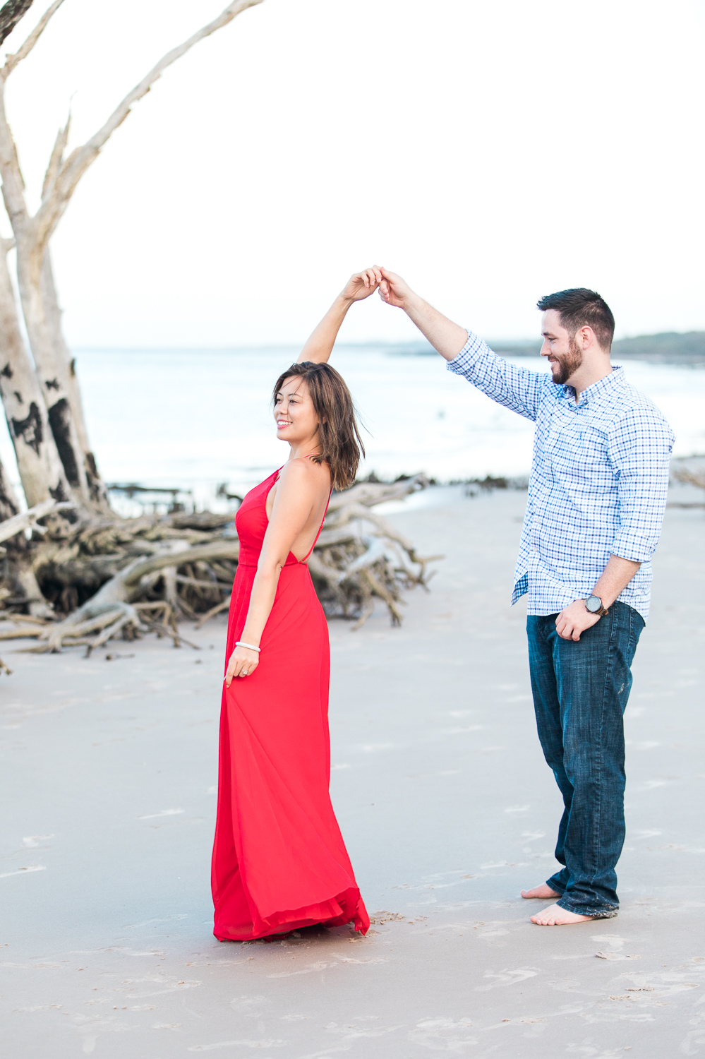Couple dancing at the beach during engagement session in Big Talbot Island