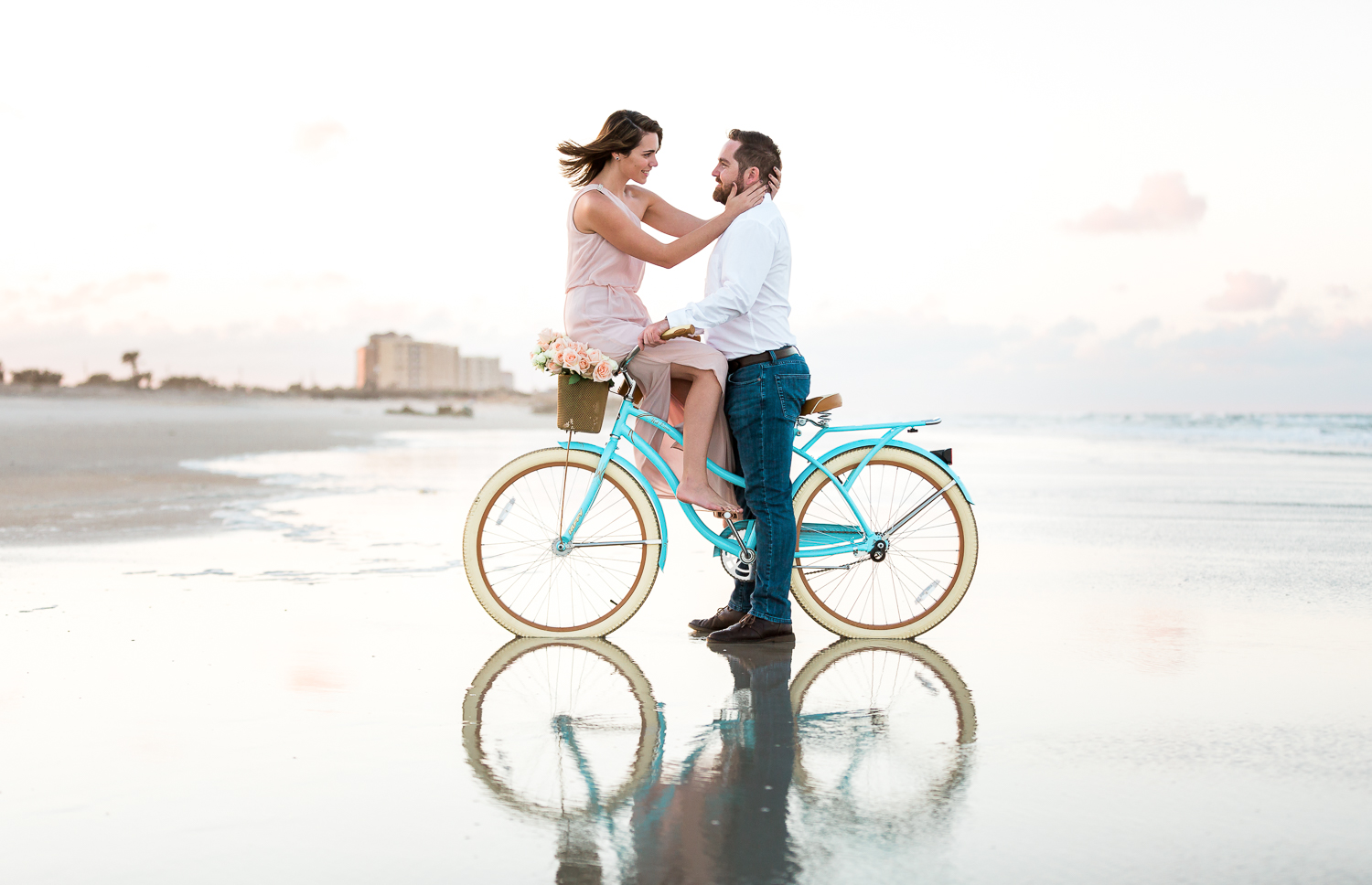 sunsete couple engagement picture ideas with a beach cruiser + posing ideas
