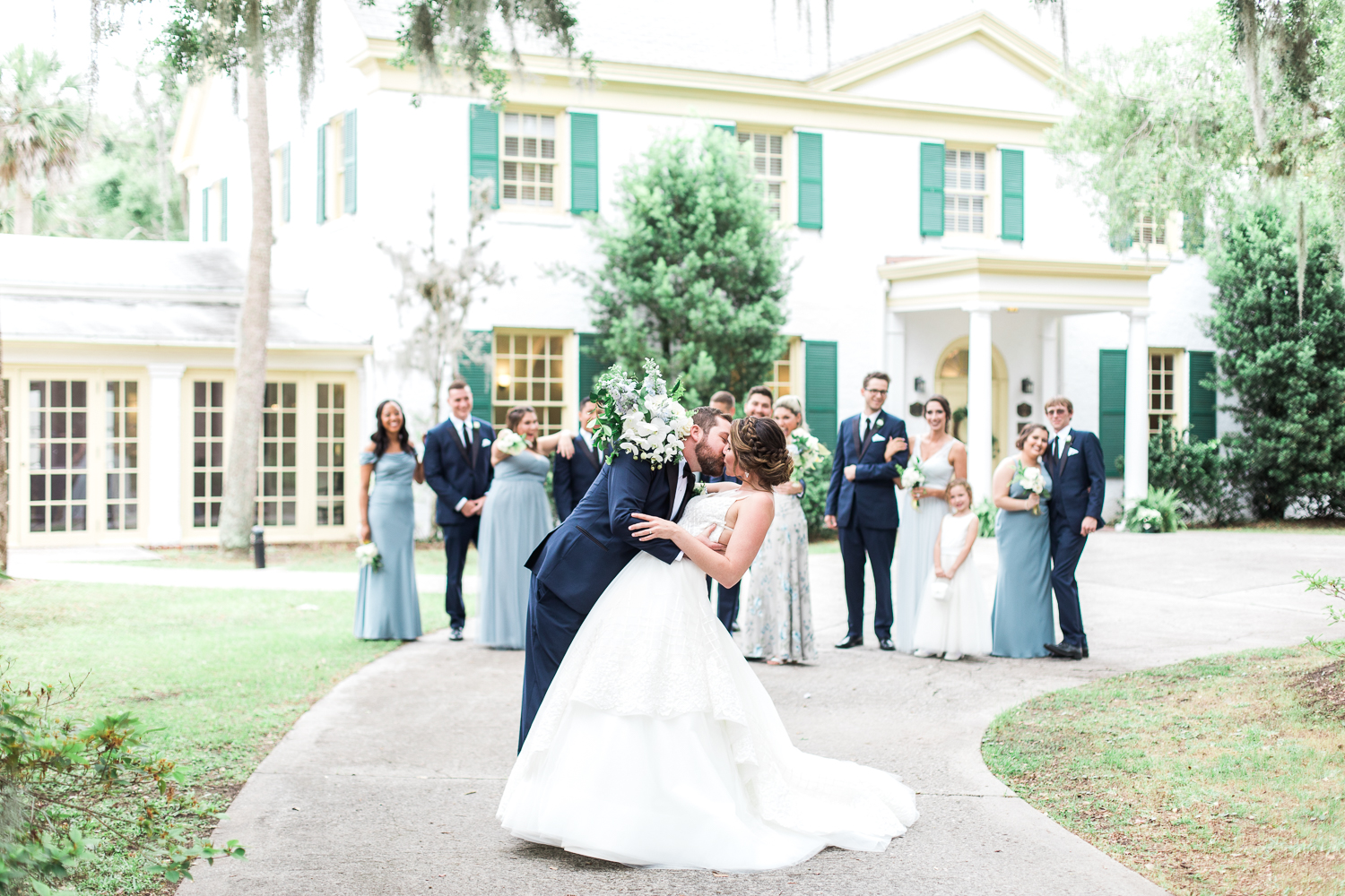bride and groom with the wedding party at the ribault club near amelia island, fl
