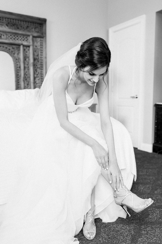 bride getting ready for her wedding in casa monica hotel in st.augustine, fl