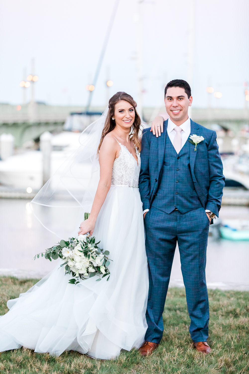 villa blanca wedding in st.augustine, fl - bride and groom by the marina during sunset + posing ideas for couples