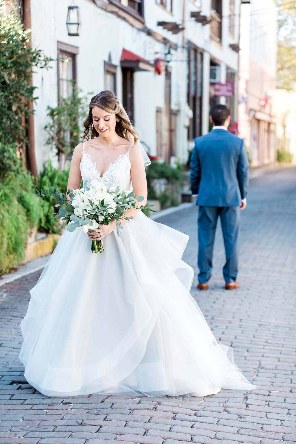 bride and groom first look at the streets of st.augustine in a winter wedding in villa blanca