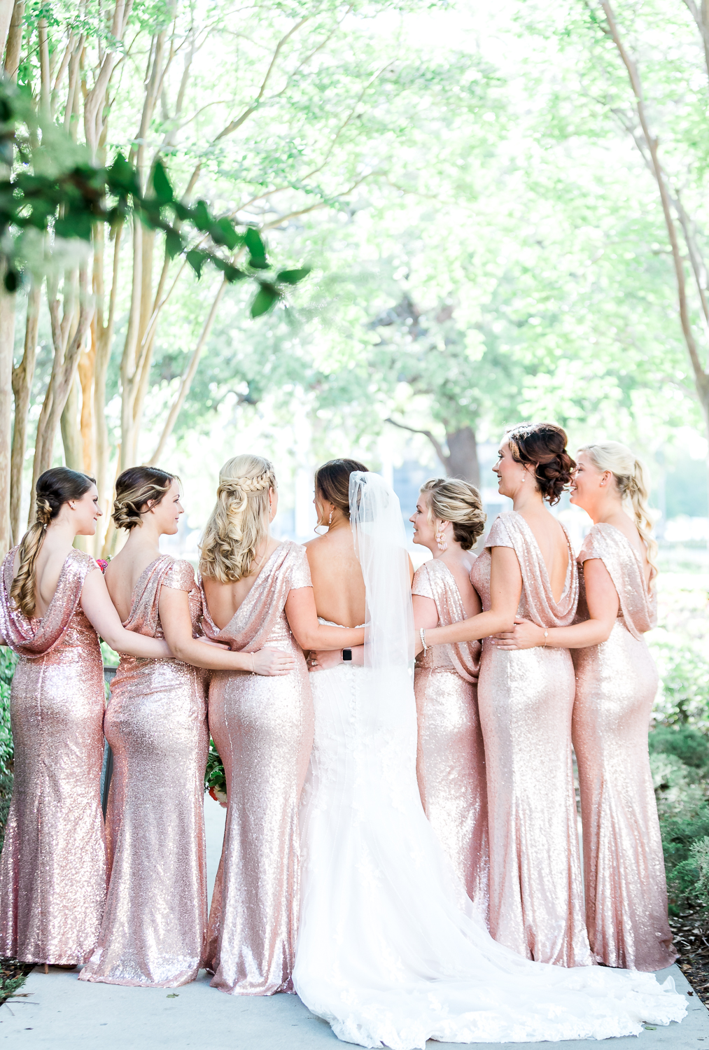 bride and her bridal party in rose gold maxi sequin dresses in downtown jacksonville winter wedding