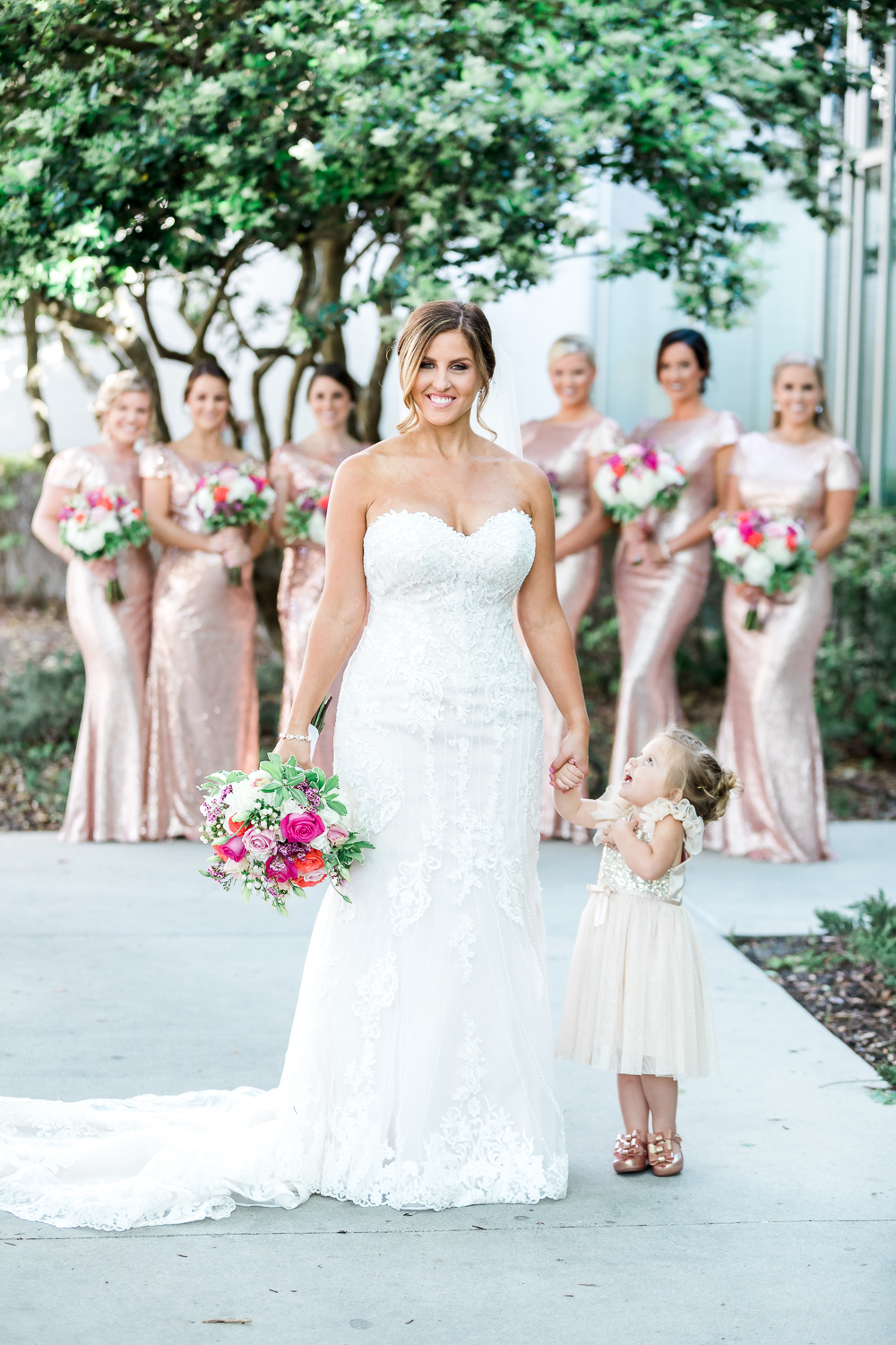 bride with her bridal party and flower girl in rose cold sequin  maxi dresses during florida yacht club wedding
