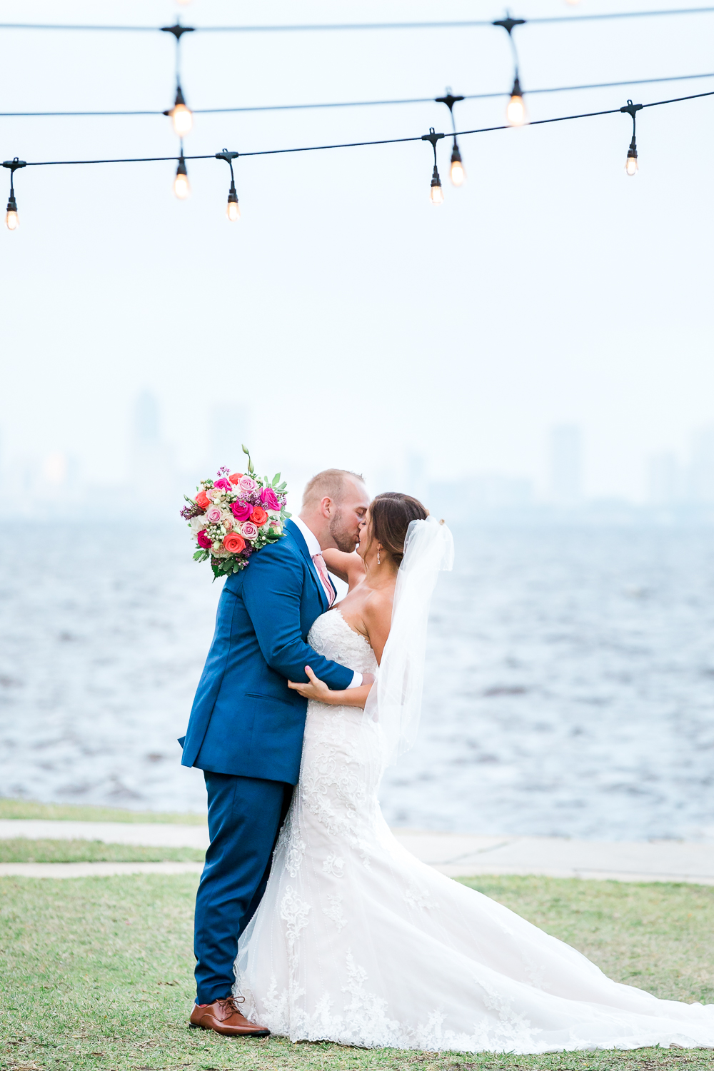 bride and groom kissing at the florida yacht club wedding overlooking downtown jacksonville