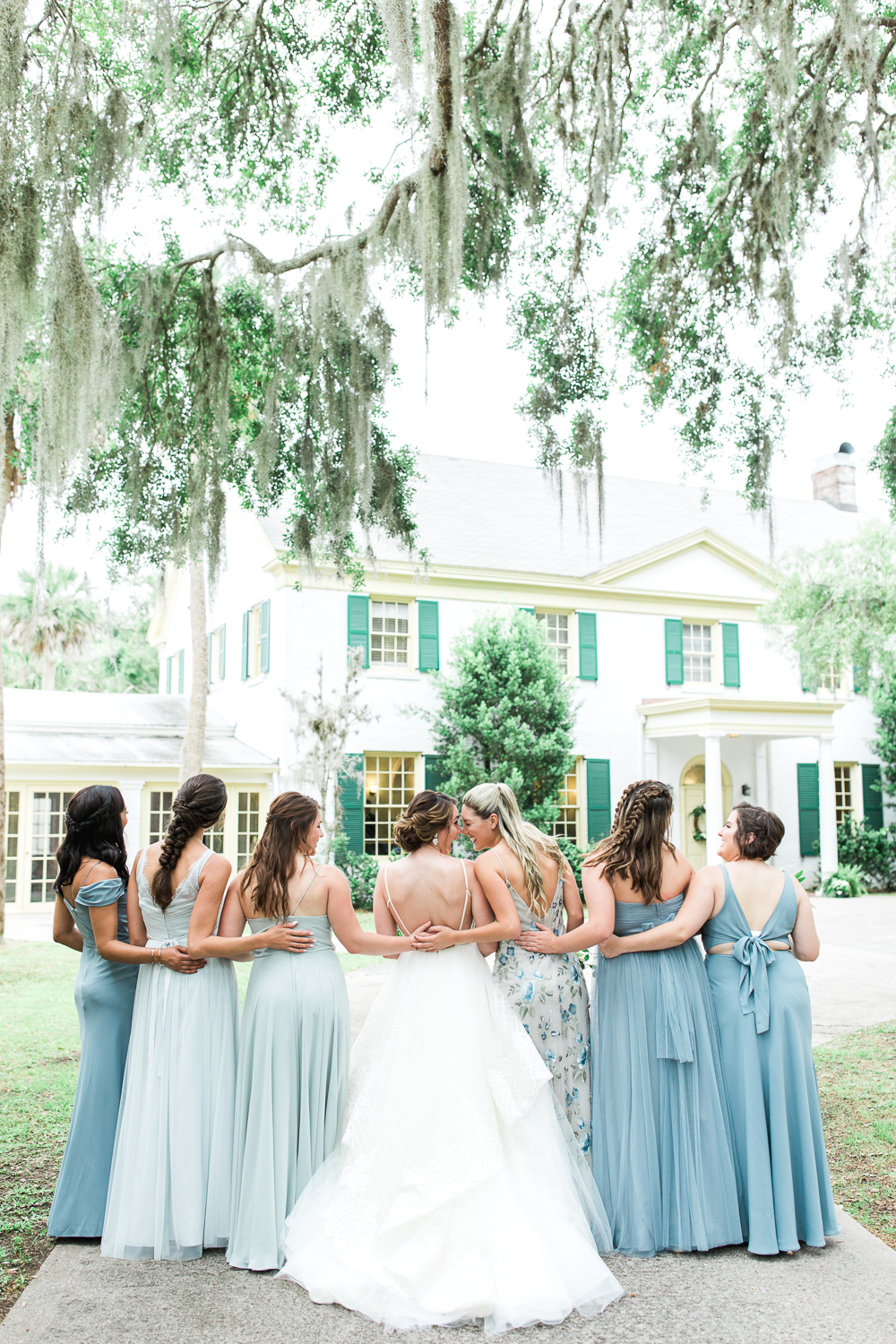 bride and bridesmaids pictures at the ribault club uring the wedding