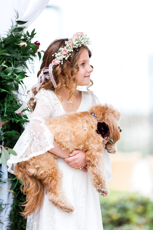 flower girl with her dog in casa marina wedding in jax beach
