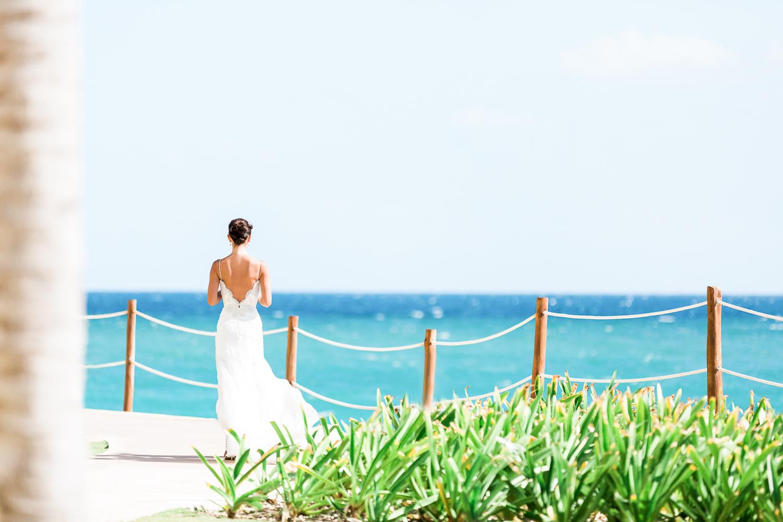 bride in cancun, mexico destination wedding by the ocean