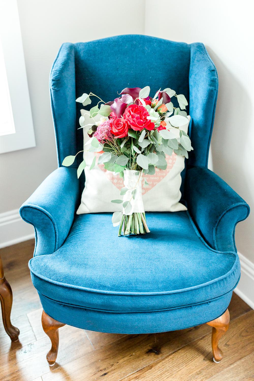 bride's bouquet in a blue vntage chair in sawgrass marriott wedding in ponte vedra beach