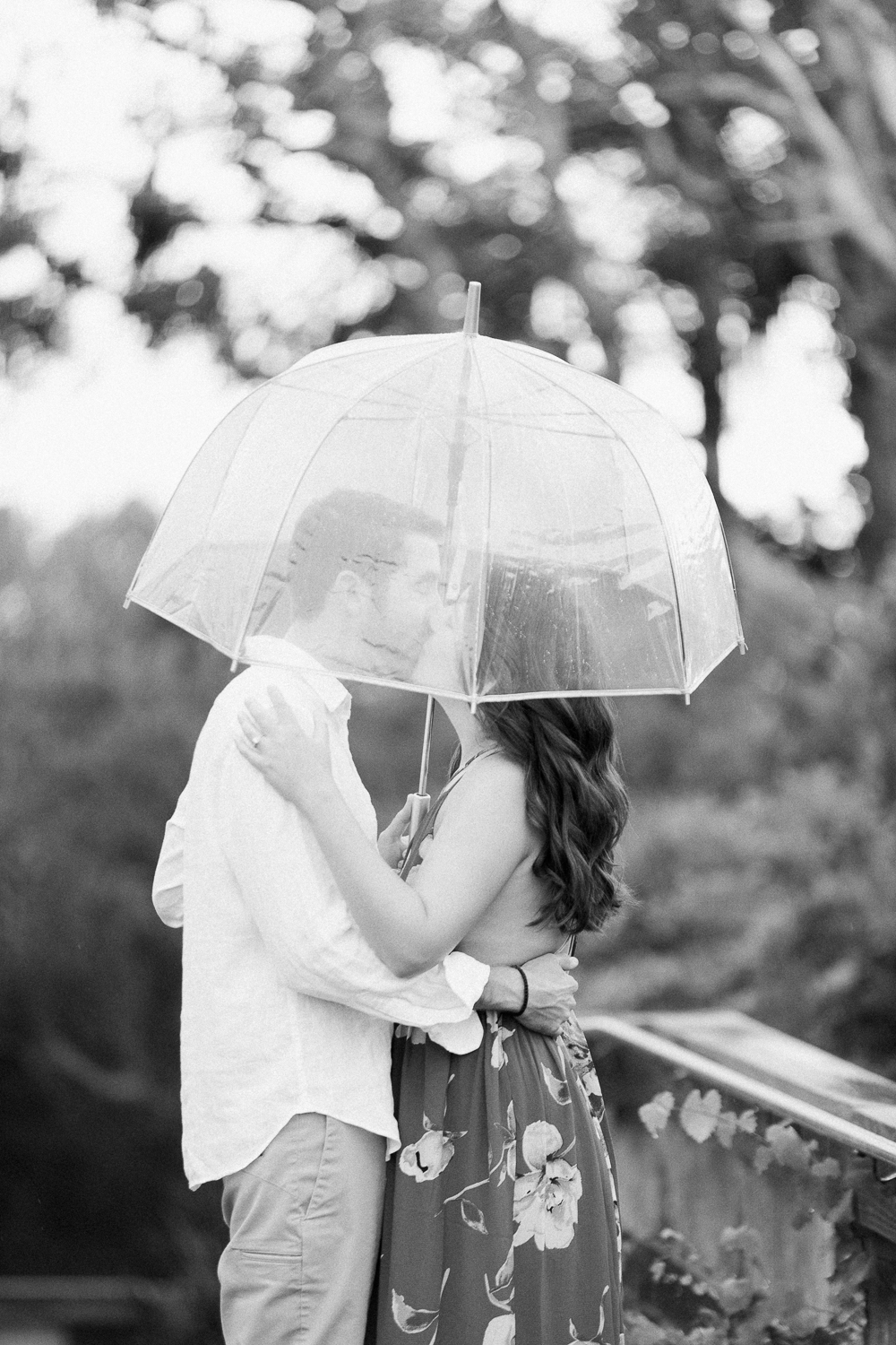 engagement session in the rain with umbrella