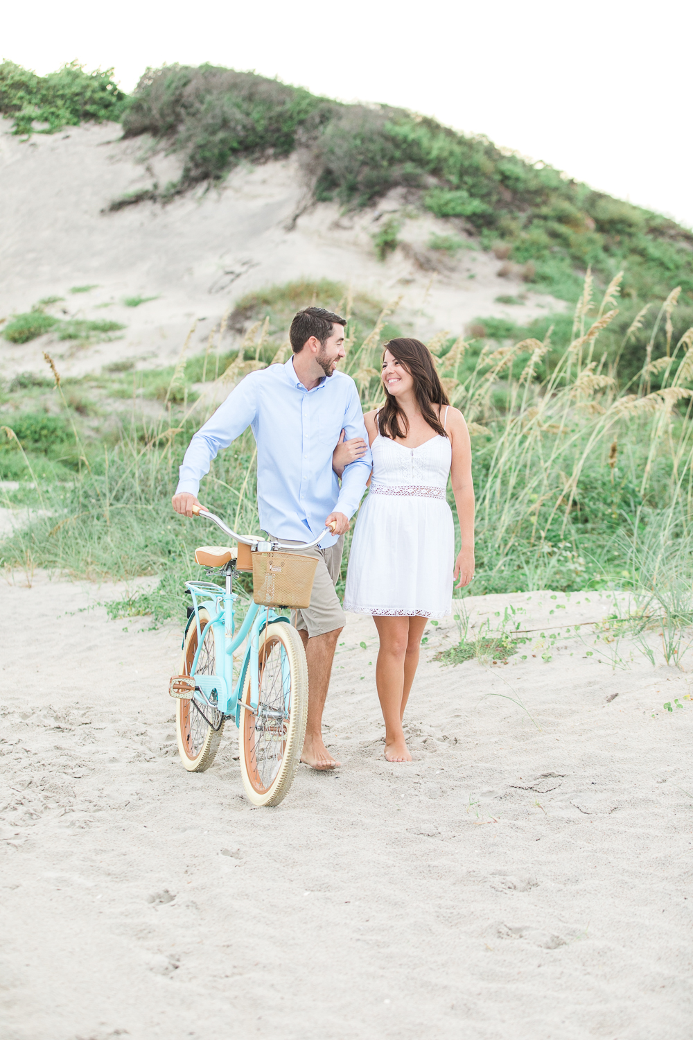 beach cruiser bike couple engagement pictures