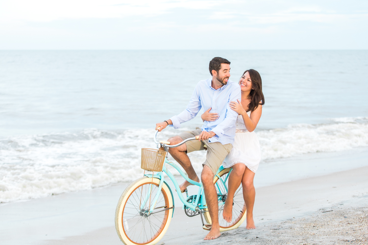 couple engagement photoshoot ideas with a beach cruiser bike