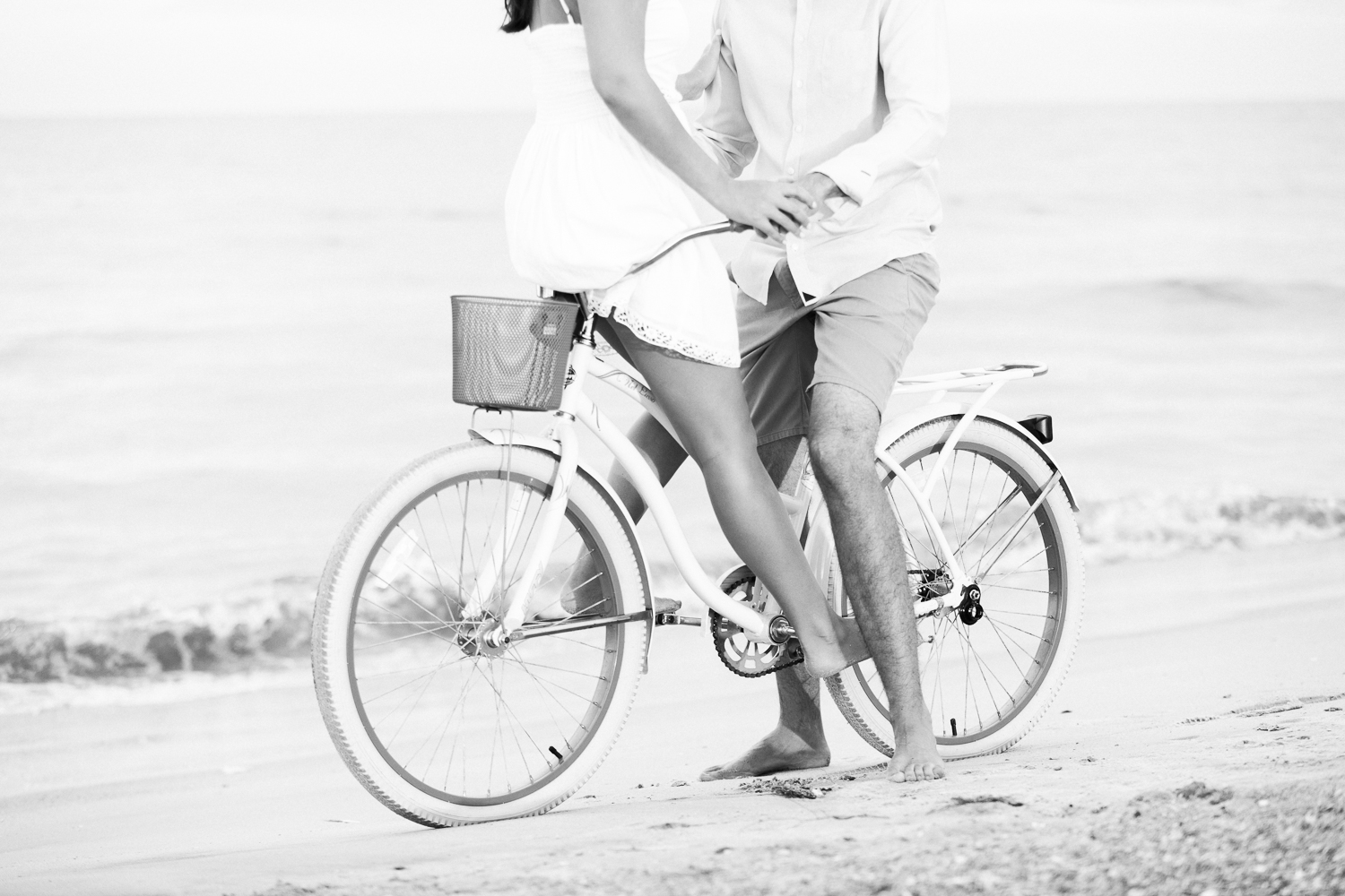 sexy and romantic engagement picture ideas with a beach cruiser bike for couples