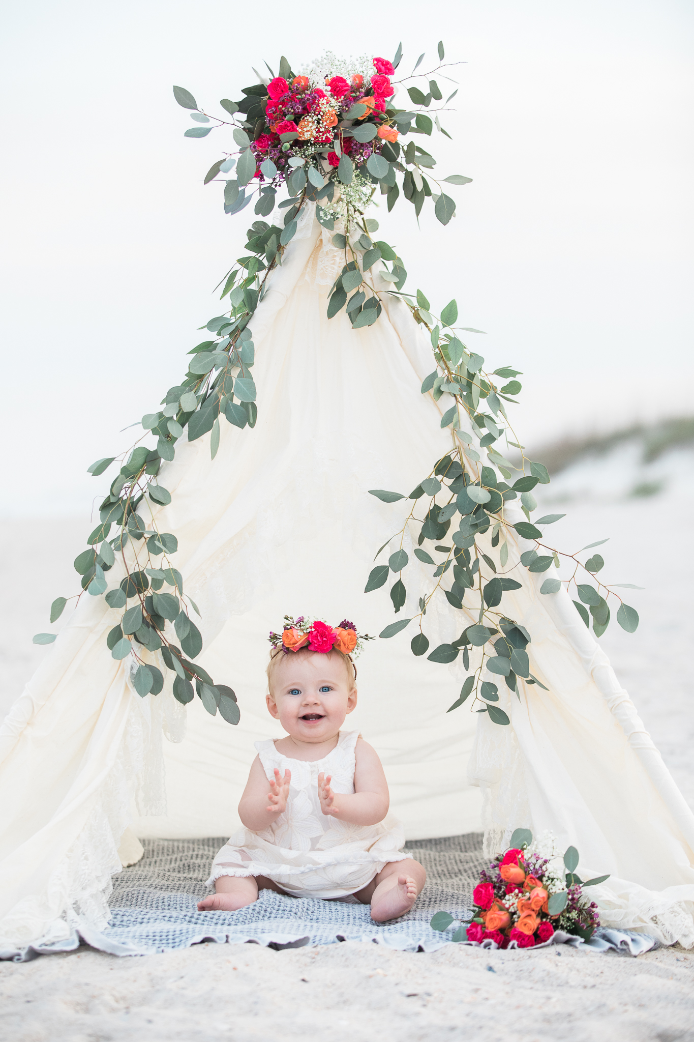 beach first birthday session with teepee and flowers.jpg