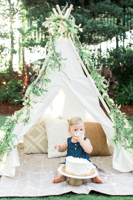 boy first birthday photoshot ideas with teepee