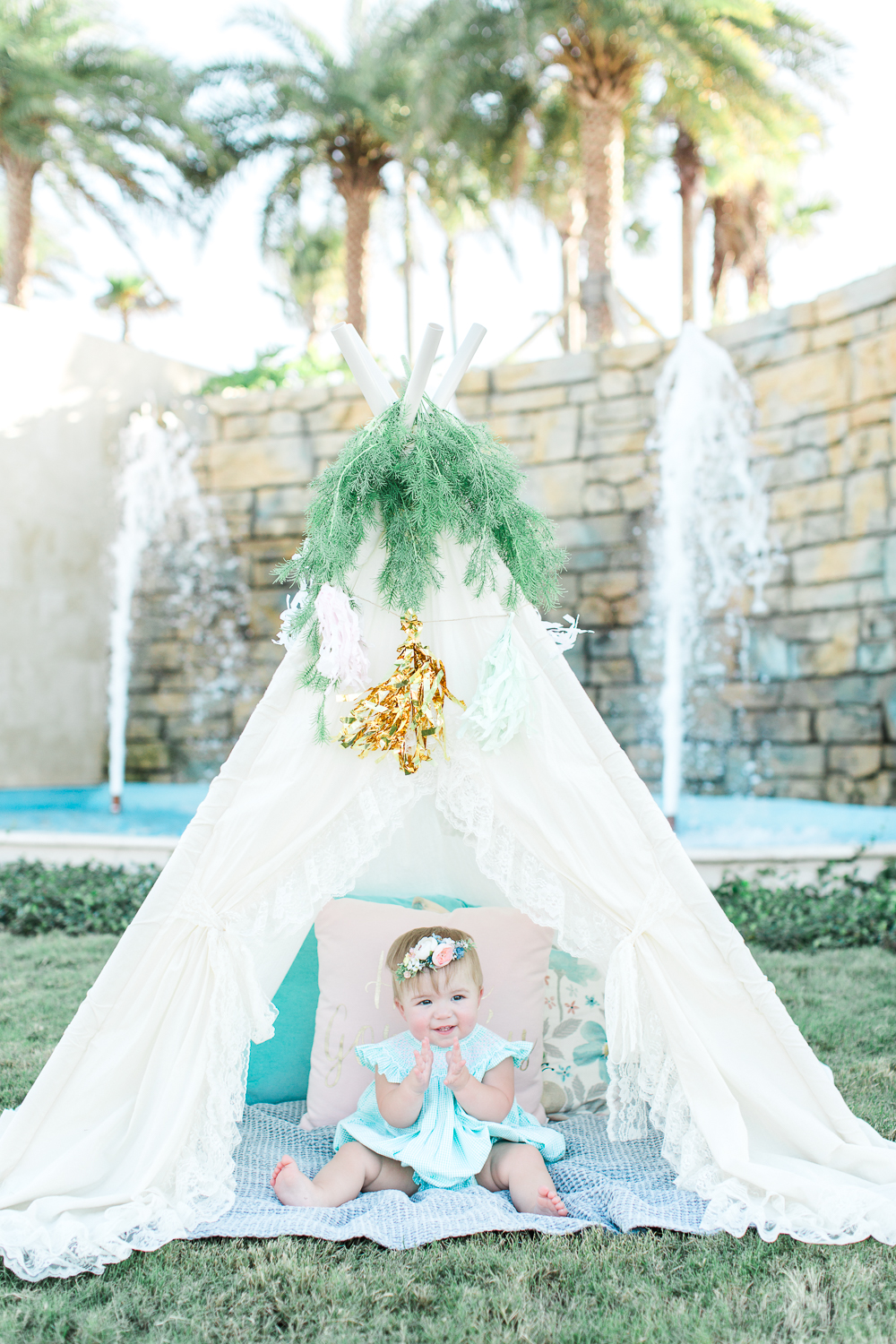 first birthday picture ideas with teepee tent, floral cown and fountain in ponte vedra, fl