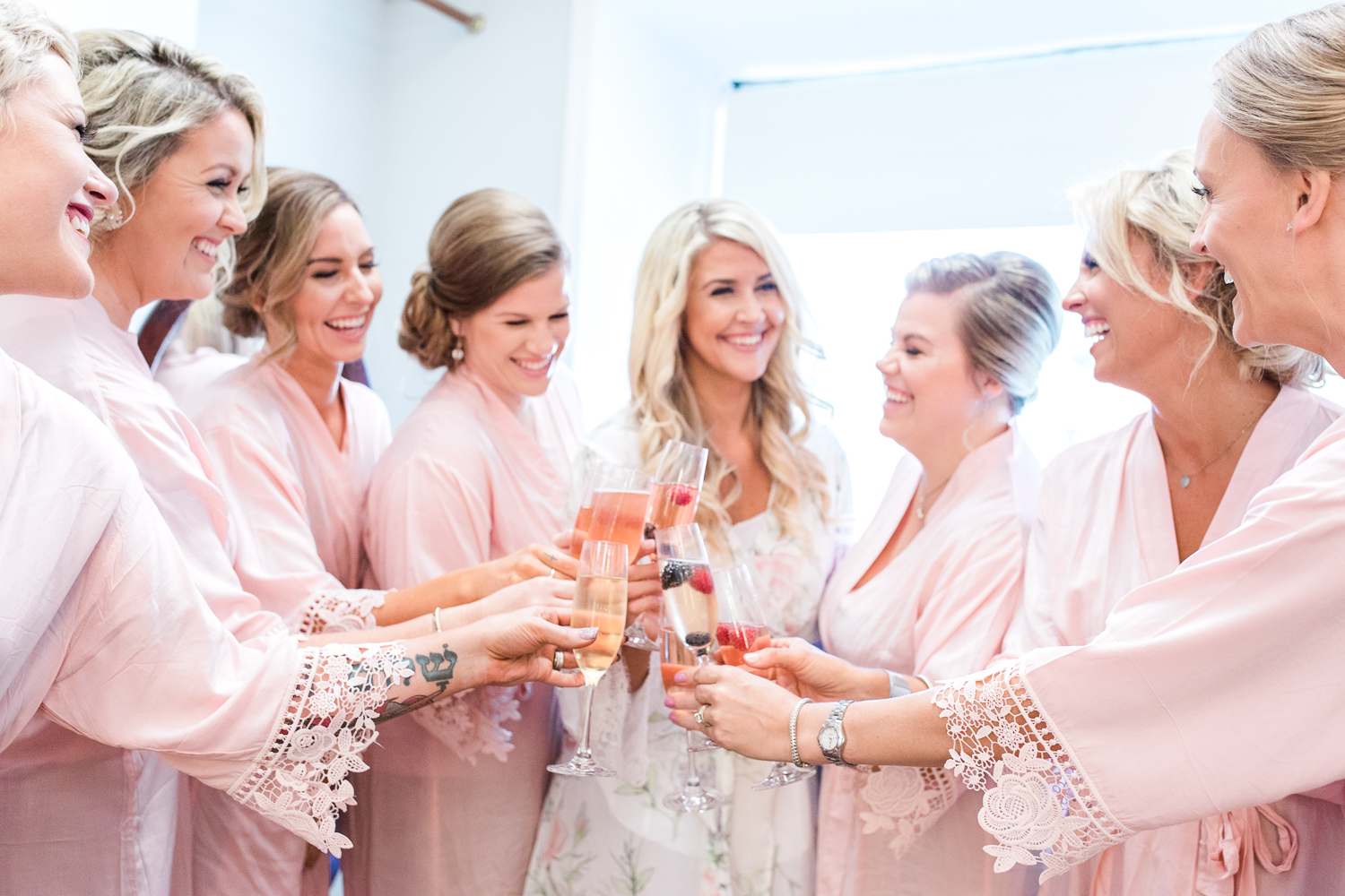 bride and bridal party drinking champagne