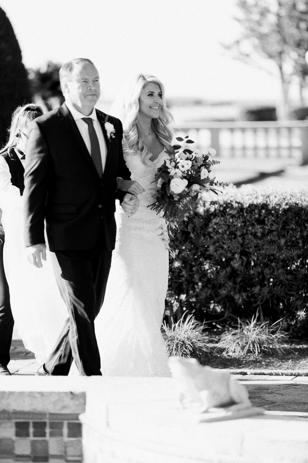 bride walking down the isle with her dad