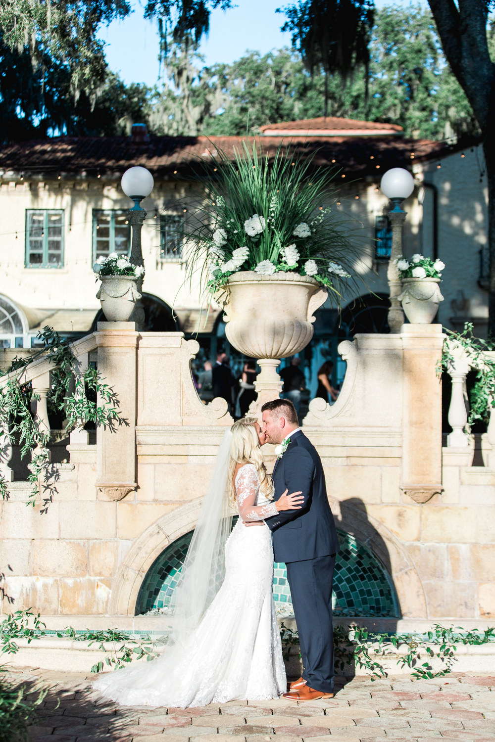 bride and groom's first kiss in this stunning mediterranean style venue