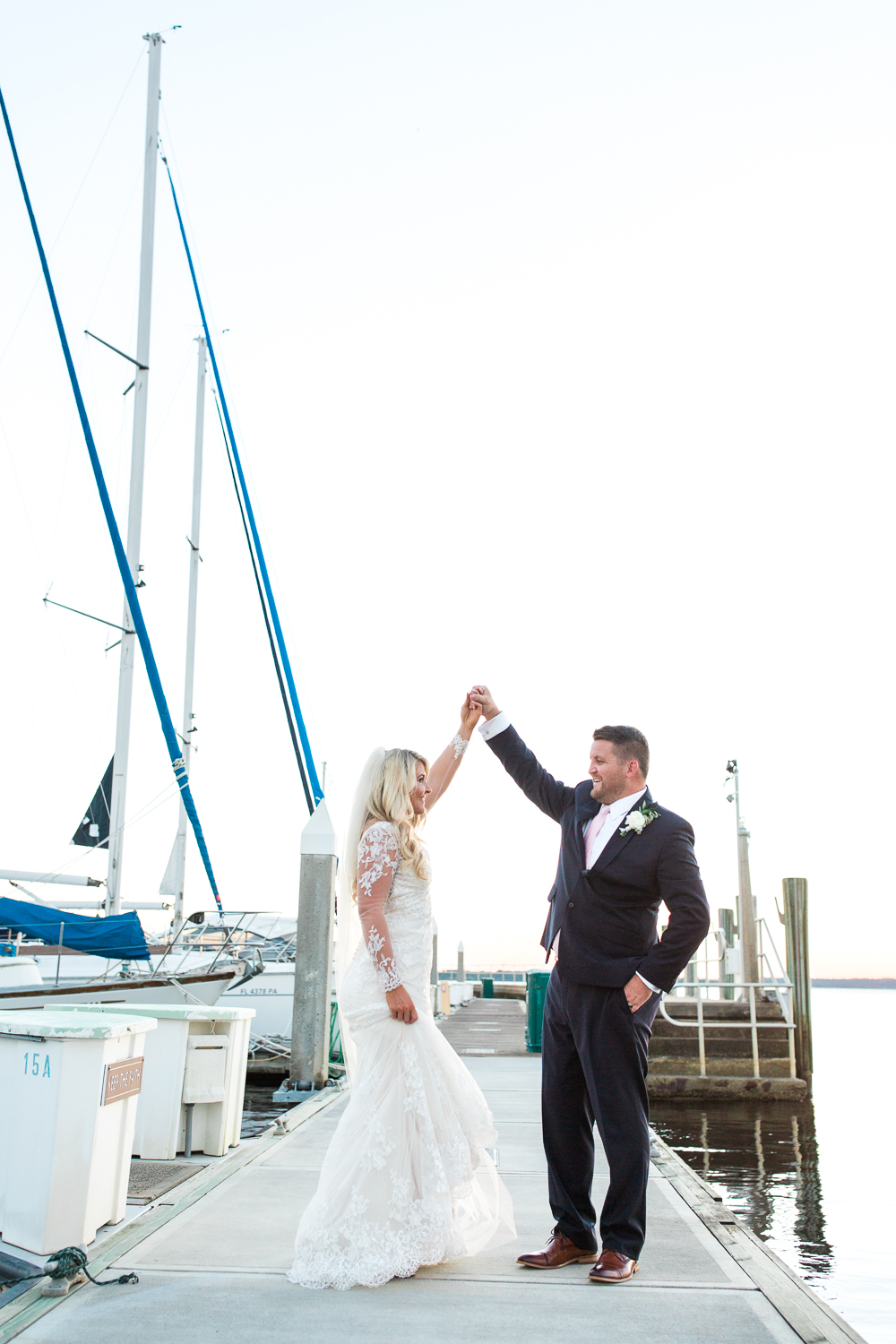 bride and groom dancing during the sunset in epping forest yacht club