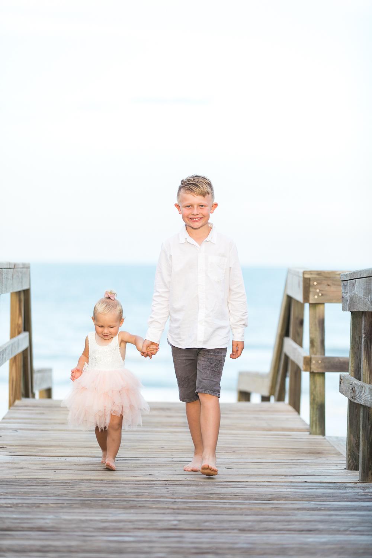 children walking at the beach