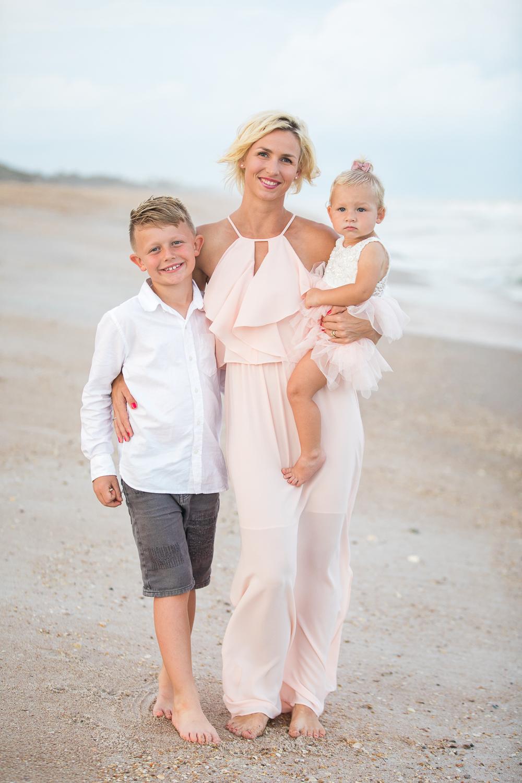 family posing at the beach in ponte vedra, fl