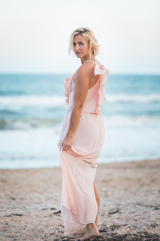 posing ideas for women wearing a long ruffle maxi dress