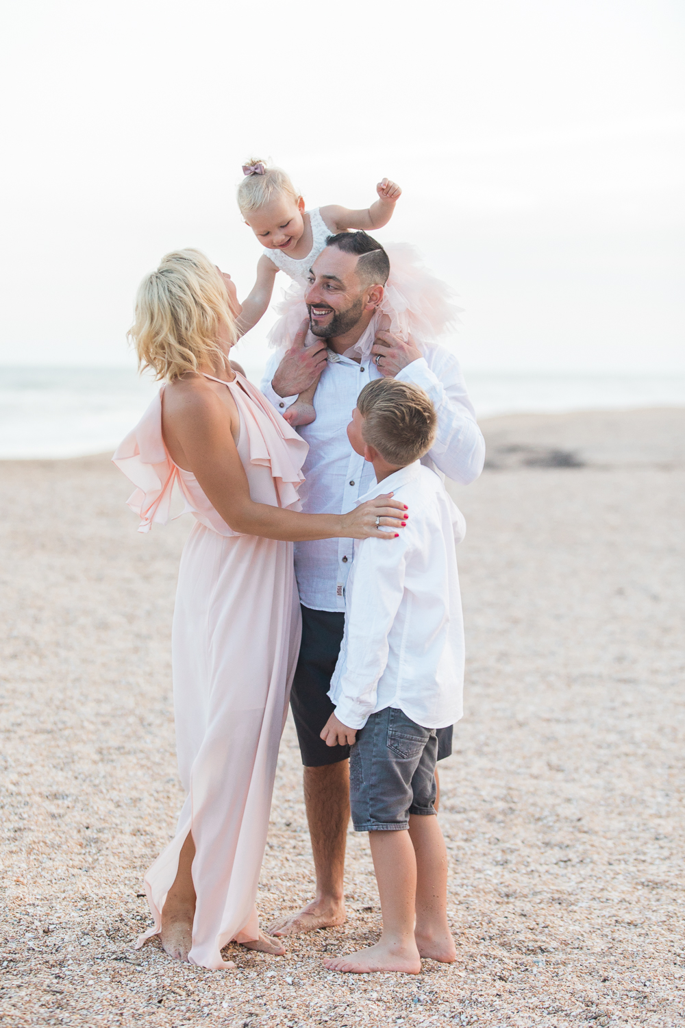 playful family pictures at the beach