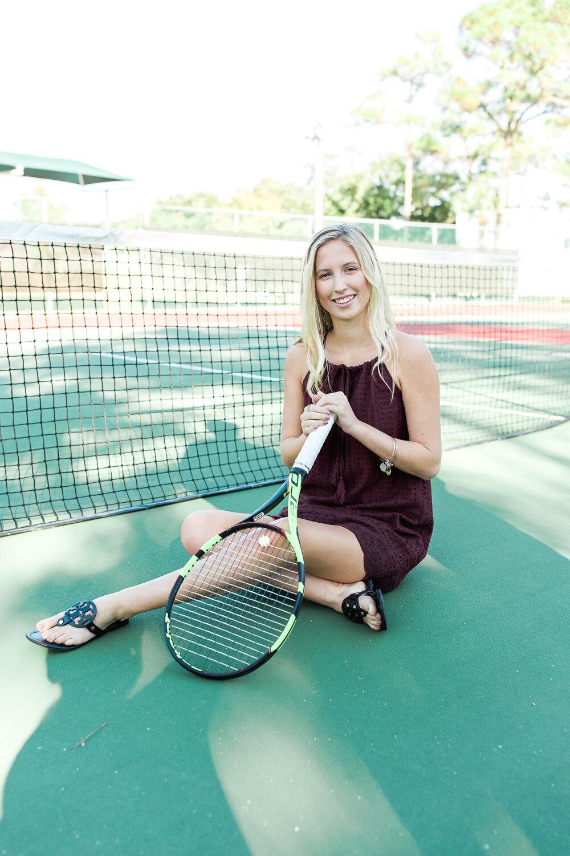 senior photoshoot in the tennis court