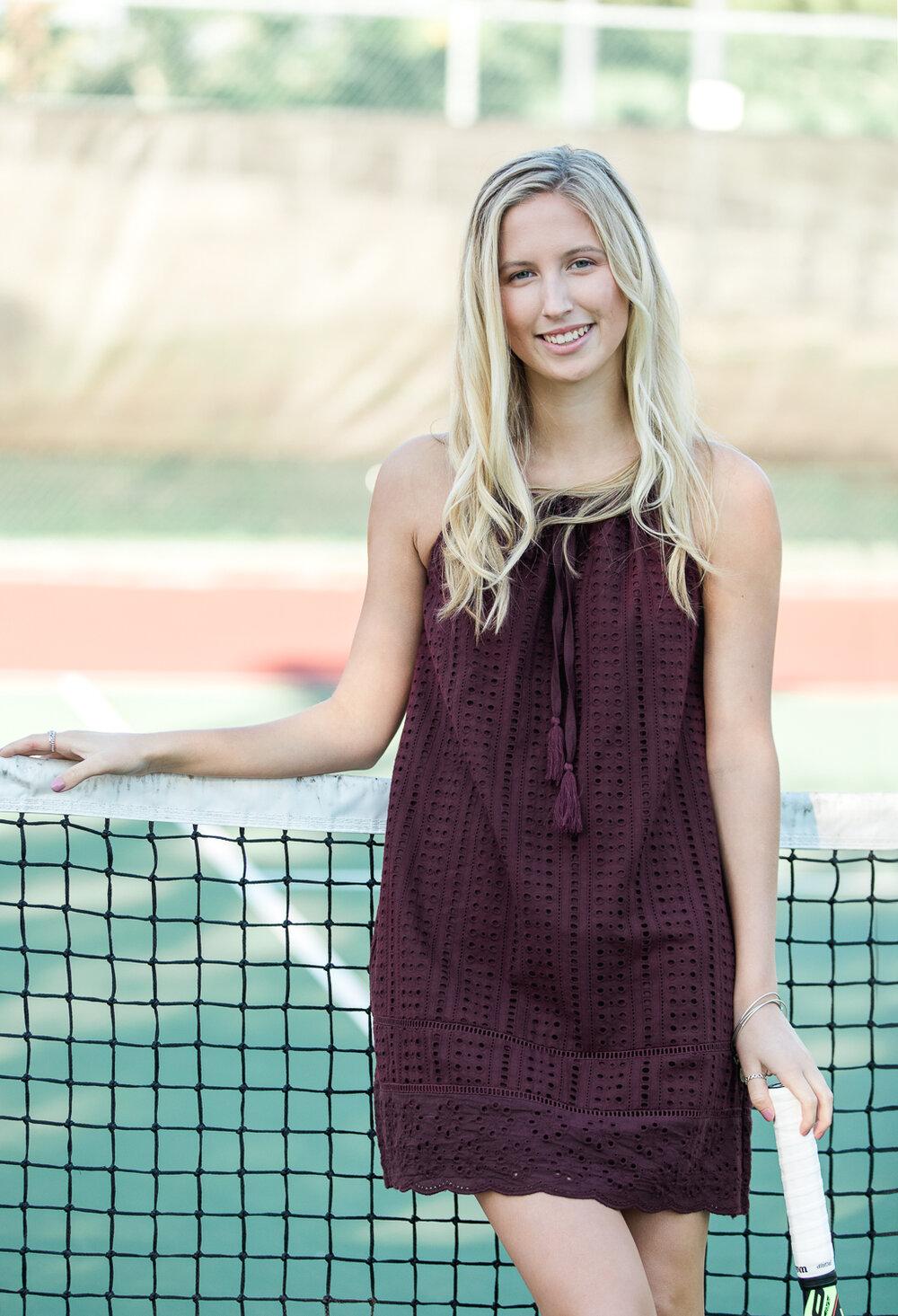 high school senior posing at the tennis court
