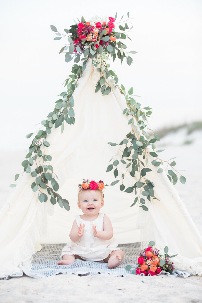 styled first birthday session at the beach in Hanna Park with a teepee tent and flowers