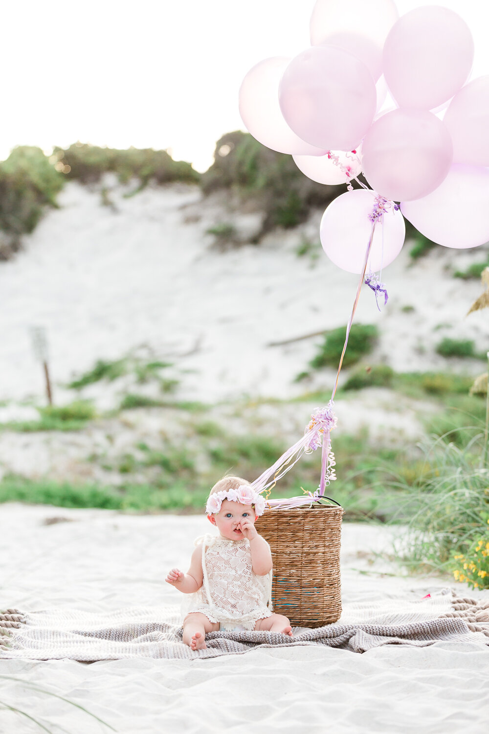 First birthday session at the beach in Hanna park with a basket and balloons