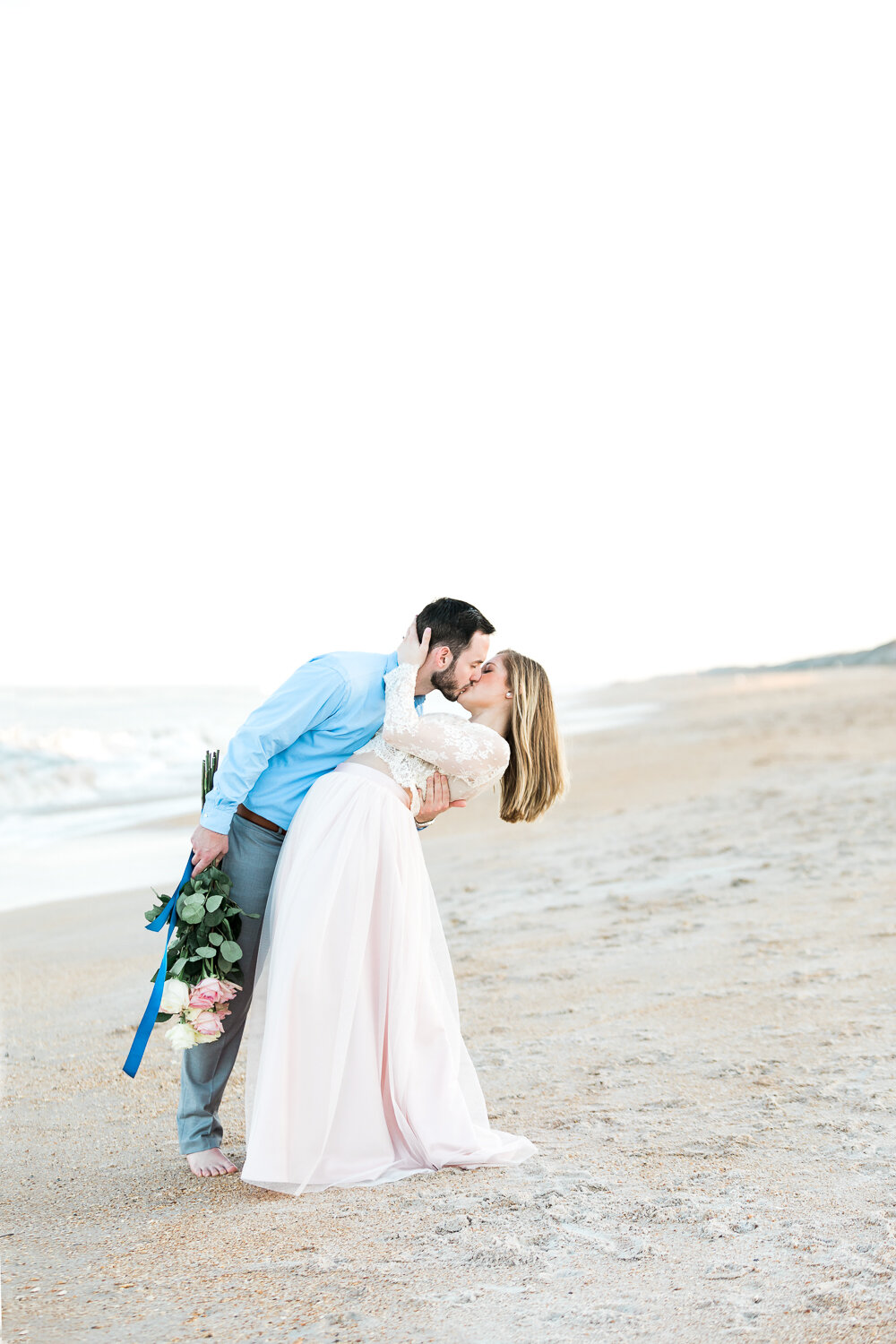 Couple engagement session posing and outfit inspiration in Guana Beach