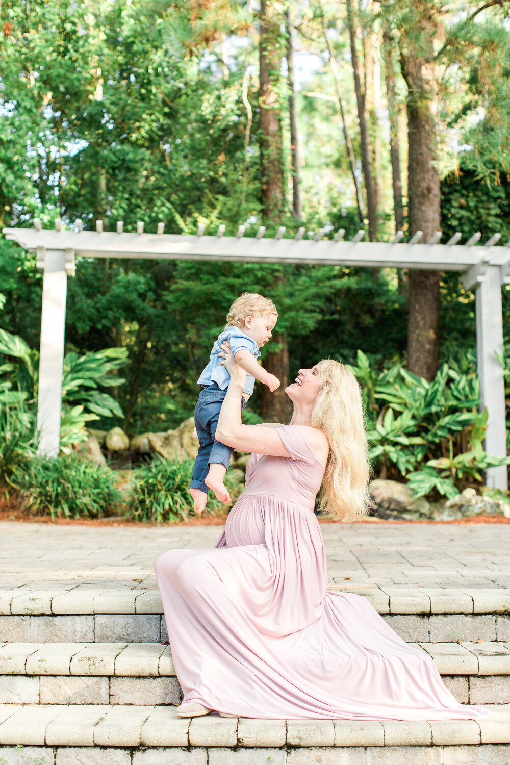 family maternity session in jacksonville golf and country club by the gazebo