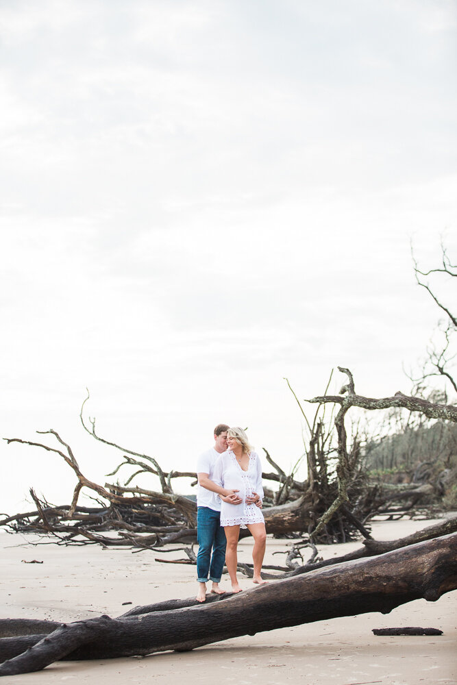 sunrise maternity session with all the driftwood in Big Talbot Island