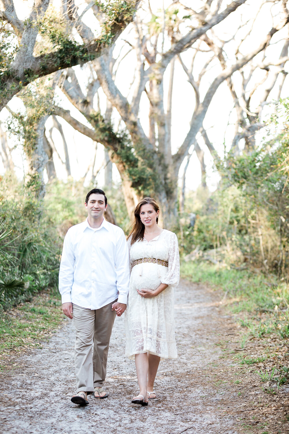 sunset maternity session in the wooded area in Big Talbot Island