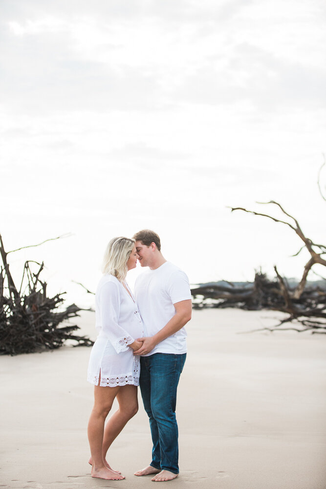 sunrise maternity session in Big Talbot Island driftwood beach