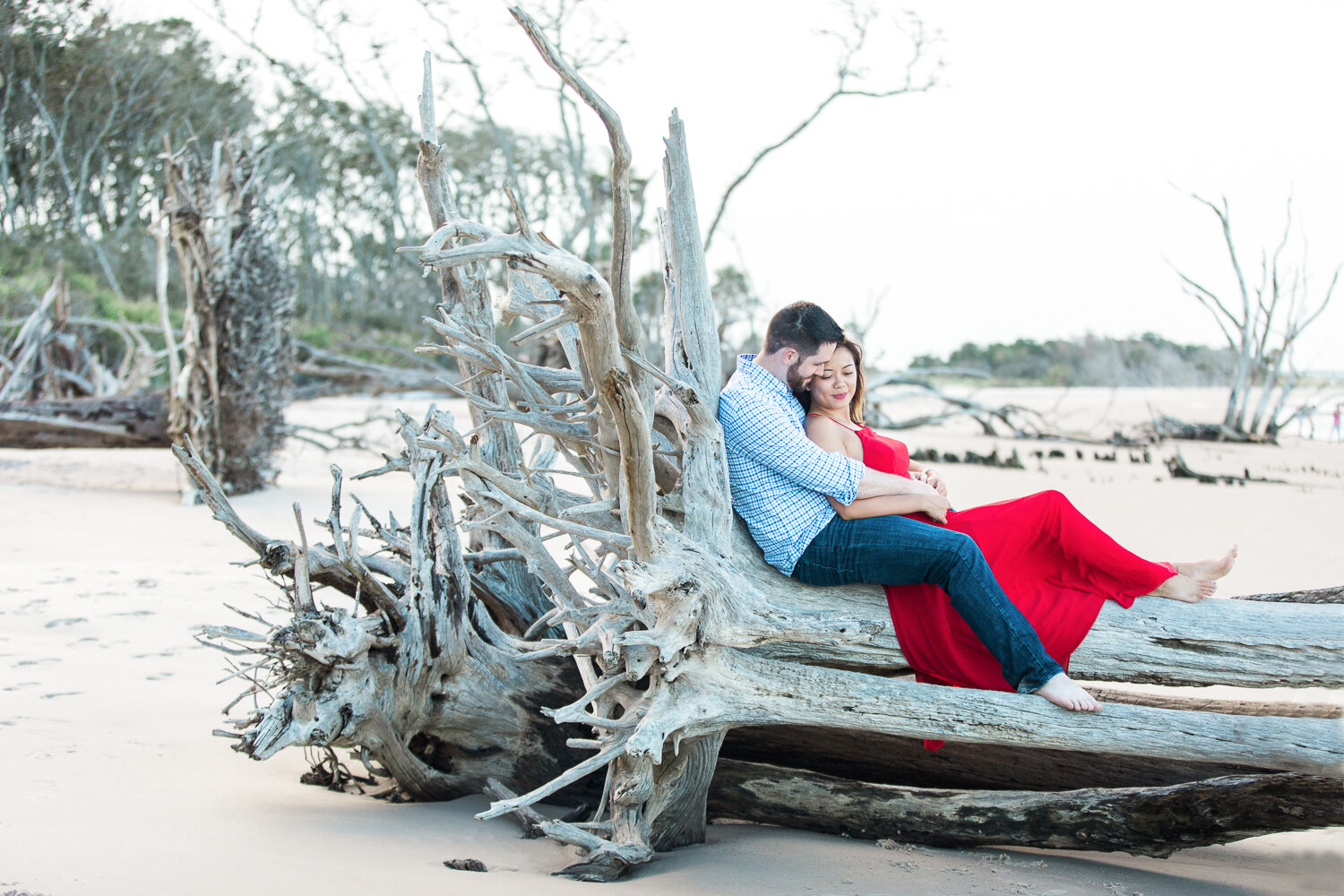 engaged couple posing and outfit inspiration in Big Talbot Island driftwood beach