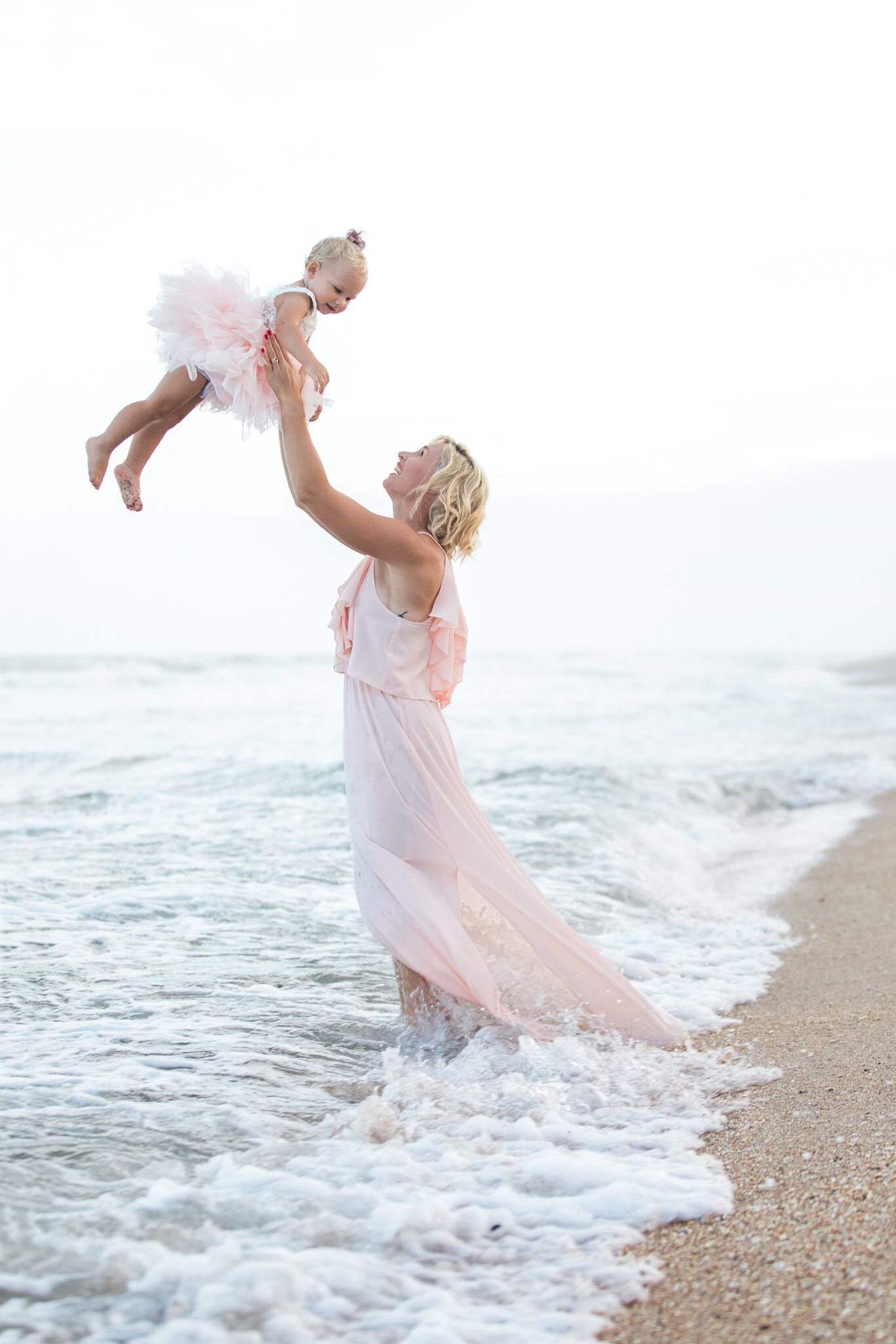 mommy and me pictures in the ocean in Guana beach