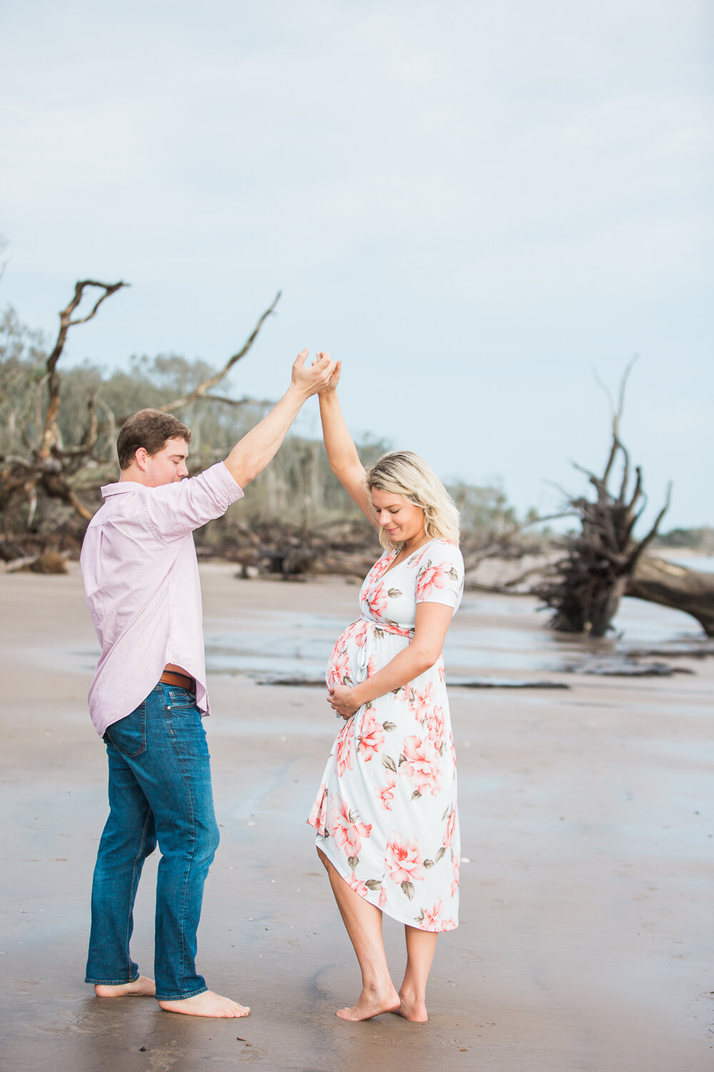 pregnant couple dancing at the beach in big talbot island