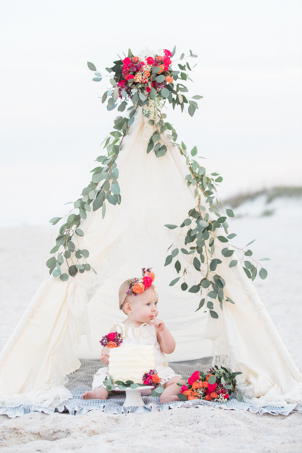 teeptee tent with florals on first birthday cake smash photoshoot