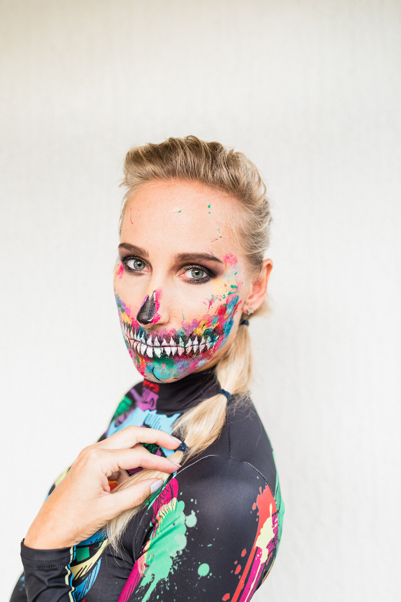 creative Halloween skeleton makeup with paint dripping