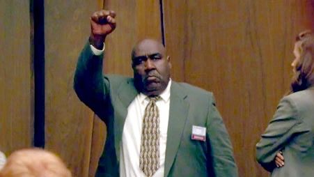 Juror Lionel (Lon) Cryer giving O.J. the black power fist. As  The New York Times  reported, Cryer was a former Black Panther whom prosecutors had inexplicably left on the panel.