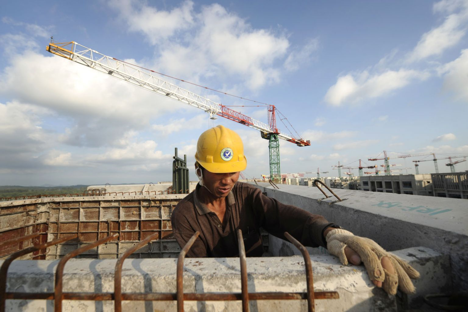 Migrant worker in Singapore. Source:  The Straits Times .