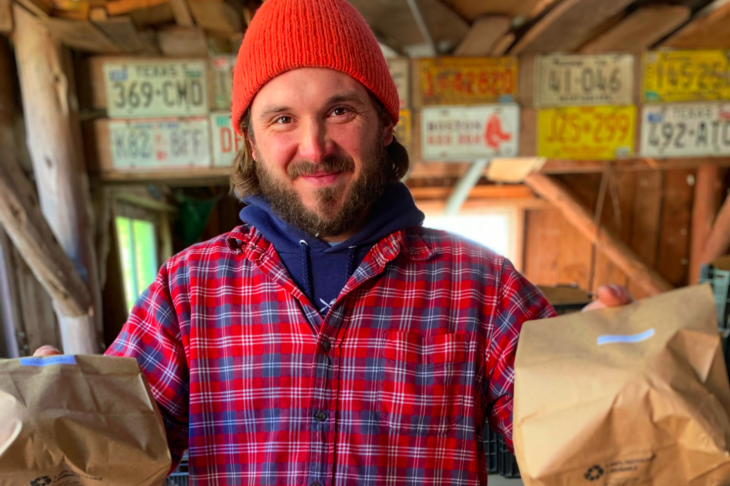 Steve packing bags of apples in the barn.
