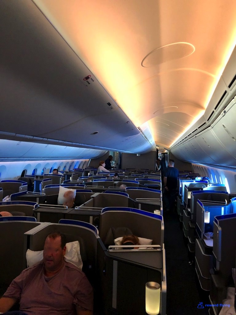 UA2418 Cabin Aisle Rear Sunrise light.jpg